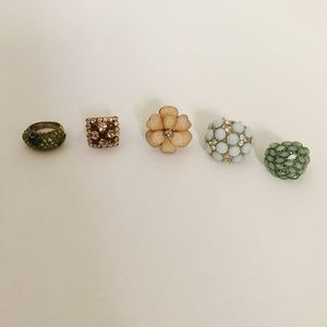 Five statement piece rings along with rings stand